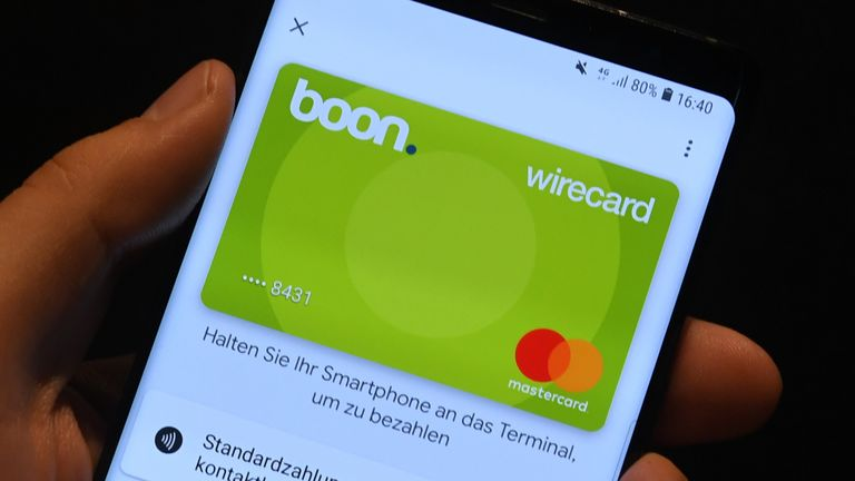 Picture taken on September 18, 2018 shows the digital credit card on a mobile phone being demonstrated in the headquarters of the technology and financial services company Wirecard in Aschheim near Munich, southern Germany.