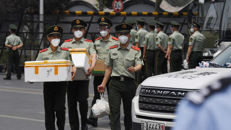 Paramilitary police officers wear face masks