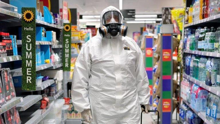 A man in full protective gear buying essentials at a shop in Wolverhampton. Pic: Anand Chhabra
