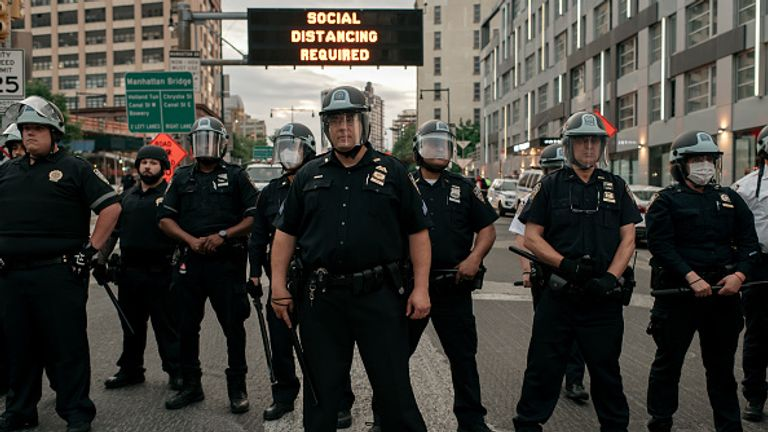 New York police blocked protesters from the entrance of the Manhattan Bridge as the curfew started