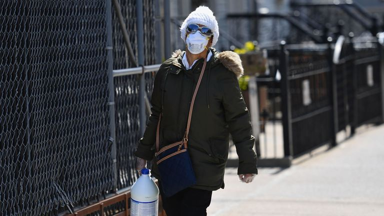 A person with a face mask carries a gallon of bleach on April 07, 2020 in Brooklyn, New York. (Photo by Angela Weiss / AFP) (Photo by ANGELA WEISS/AFP via Getty Images)