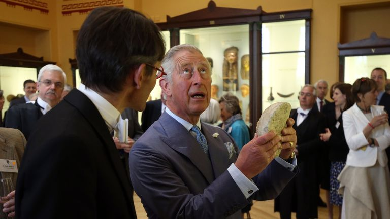 The Prince of Wales holds an historic artifact of a marble head of a young man from a Greek relief, which dates from late fifth to early fourth century BC, during a visit to Eton College near Windsor, Berkshire where he officially opened the new Bekynton Field Development building. 09-Jun-2015