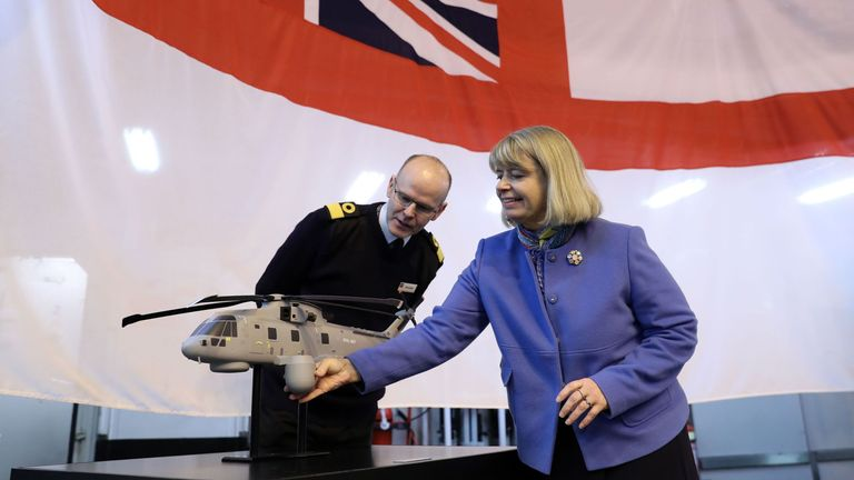 Minister for Defence Procurement Harriett Baldwin (right) and Commodore Steve Allen, Royal Navy, Assistant Chief of Staff Aviation, look at a model of a Merlin helicopter with the CROWSNEST Airborne Early Warning system fitted, on board HMS Dragon - a Type 45 Air Defence Destroyer - at Portsmouth Naval Base, where an announcement for a multi-million pound deal for a new cutting-edge helicopter-borne surveillance system designed to protect Royal Navy ships