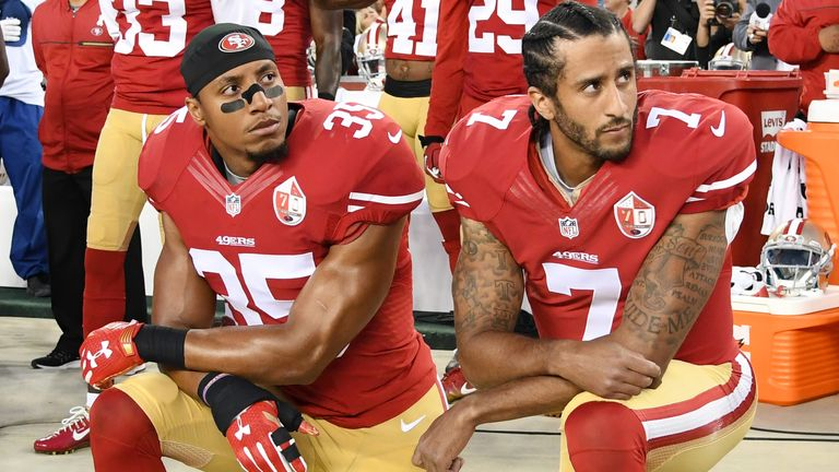 Colin Kaepernick and Eric Reid kneeling in protest against police brutality and racial oppression in 2016