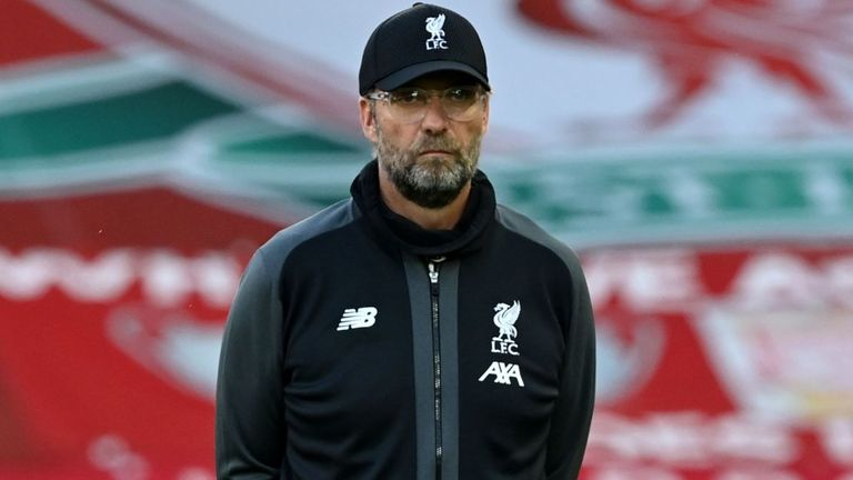 Liverpool's German manager Jurgen Klopp watches his players warm up ahead of the English Premier League football match between Liverpool and Crystal Palace at Anfield in Liverpool, north west England on June 24, 2020.