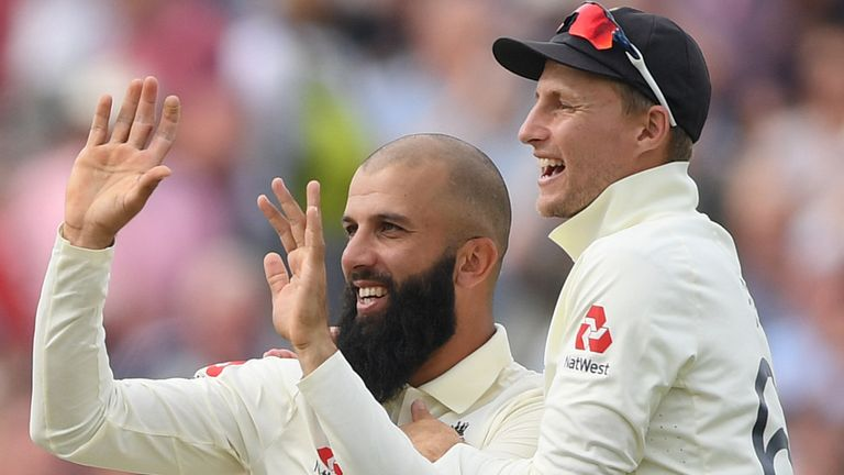 Moeen Ali and Joe Root celebrate a wicket
