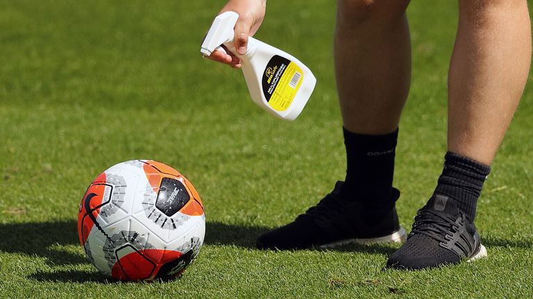 A Premier League call is sprayed with disinfectant during training