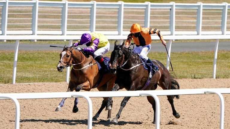 Zodiakos (near side) wins the first race at Newcastle as racing returns in Britain