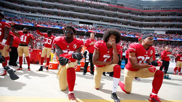 Colin Kaepernick (centre) has not played in the NFL since 2016 when he gained widespread attention for 'taking a knee'