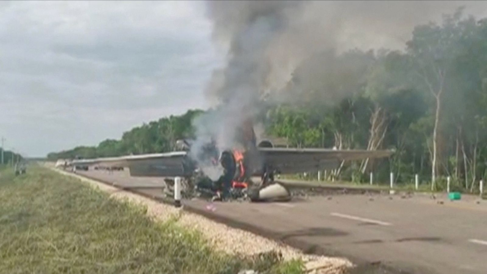 Mexico: Suspected drugs plane found in flames on road after being tailed by the military