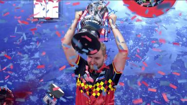 Van den Bergh lifts Phil Taylor trophy