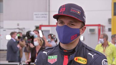 Albon smiling behind mask