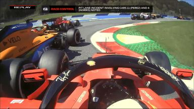 Vettel spins after clashing with Sainz