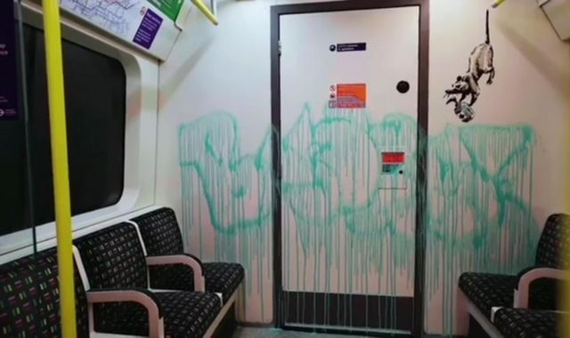 Coronavirus: Cleaners who removed Banky's face mask Tube graffiti 'did not know who painted it'