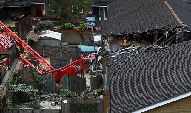 Bow crane collapse: Woman dies after crane falls on houses in east London