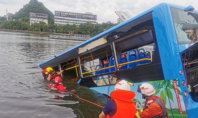 China: Twenty-one dead and 15 injured after bus crashes into lake