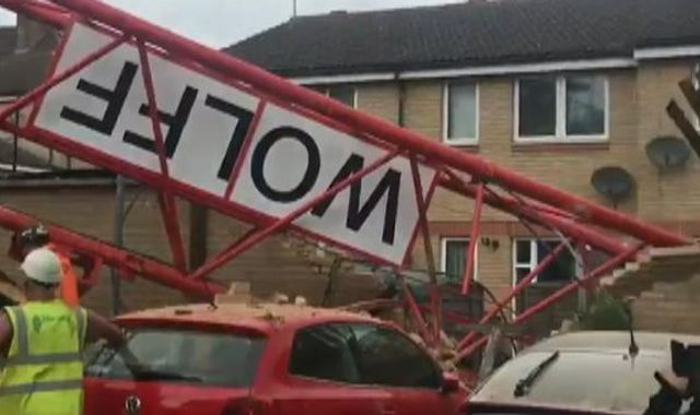 People trapped after crane collapses on house in Bow, east London