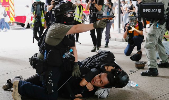 Hong Kong: Police make first arrests under controversial new security law