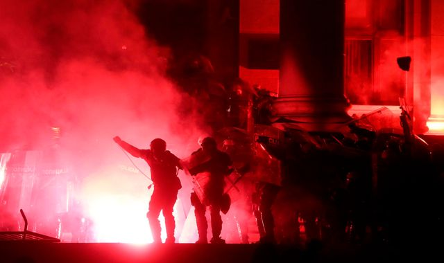Serbia: Police fire tear gas as protesters try to storm Belgrade parliament building