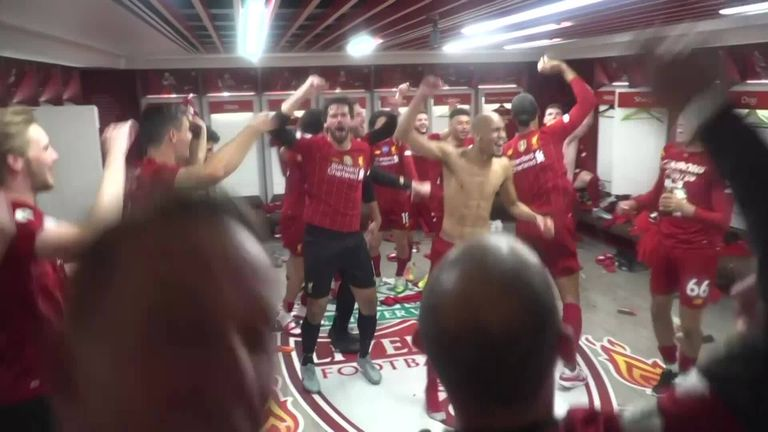 Watch the Liverpool team celebrate their title success in the Anfield changing room after their 5-3 victory over Chelsea.