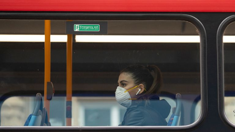 LONDON, ENGLAND - MARCH 19: A passenger wearing a face mask rides a bus on Oxford Street on March 19, 2020 in London, England. Transport for London announced the closure of up to 40 tube stations as officials advised against non-essential travel. Bus and London Overground service will also be reduced. (Photo by Dan Kitwood/Getty Images)