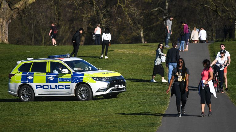LONDON, ENGLAND  - APRIL 05: A police car is seen patrolling Greenwich Park on April 5, 2020 in London, England . The Coronavirus (COVID-19) pandemic has spread to many countries across the world, claiming over 60,000 lives and infecting over 1 million people. (Photo by Peter Summers/Getty Images)