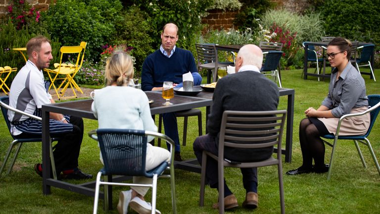 EMBARGOED TO 2230 BST FRIDAY JULY 3 The Duke of Cambridge talks to the landlords and workers at The Rose and Crown pub in Snettisham, Norfolk.
