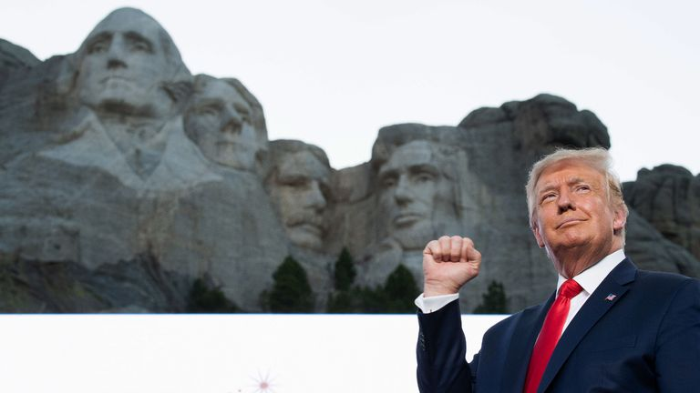 US President Donald Trump pumps his fist as he arrives for the Independence Day events at Mount Rushmore National Memorial in Keystone, South Dakota, July 3, 2020. (Photo by SAUL LOEB / AFP) (Photo by SAUL LOEB/AFP via Getty Images)