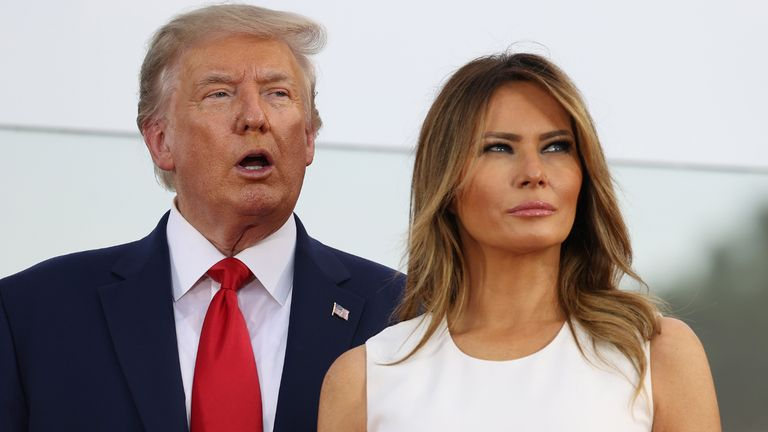 "WASHINGTON, DC - JULY 04: President Donald Trump and first Lady Melania Trump participate in an event on the South Lawn of the White House on July 04, 2020 in Washington, DC. President Trump is hosting a ""Salute to America"" celebration that includes flyovers by military aircraft and a large fireworks display. (Photo by Tasos Katopodis/Getty Images)"
