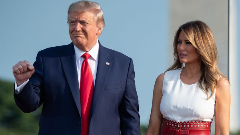 """US President Donald Trump and First Lady Melania Trump host the 2020 """"Salute to America"""" event in honor of Independence Day on the South Lawn of the White House in Washington, DC, July 4, 2020. (Photo by SAUL LOEB / AFP) (Photo by SAUL LOEB/AFP via Getty Images)"""