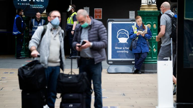 Staff and members of the public wear protective face masks inside Waverley Station, Edinburgh, as Scotland moves into the second phase of its four-step plan to ease out of lockdown.