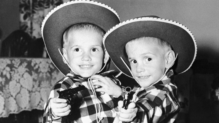 "(Original Caption) Siamese twins Ronnie and Donnie Galyon pose in their cowboy suits on their third birthday in Dayton. The children are joined at the waist. Doctors say surgery to separate them would mean death for one. Parents of the twins, Mr. and Mrs.. Wesley Galyon said ""we'll never separate them. We don't even talk about it anymore."" In walking, the boys take turns going backwards."