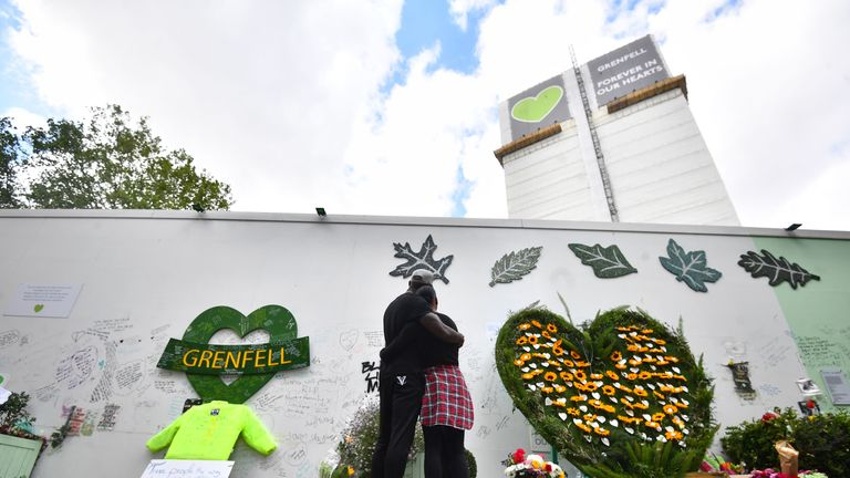 People at the Grenfell Memorial Community Mosaic next to the tower block in London on the third anniversary of the Grenfell Tower fire which claimed 72 lives on June 14 2017.