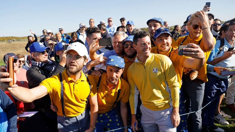 Rory McIlroy of Northern Ireland and Europe has a photo with fans by the 10th green in his final practice round ahead of the 2018 Ryder Cup at Le Golf National near Versailles on September 27th 2018 in France (Photo by Tom Jenkins)
