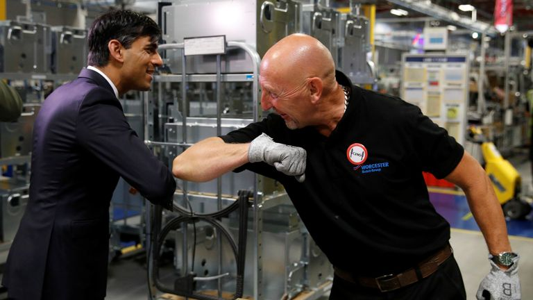 Chancellor of the Exchequer Rishi Sunak greets an employee during his visit to Worcester Bosch factory to promote the initiative, Plan for Jobs.
