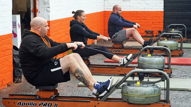 People take part in a small exercise class at the Lionheart Fitness gym in Bedlington, Northumberland, which has moved some equipment into the car park as indoor gyms are still not permitted to open due to coronavirus lockdown restrictions.