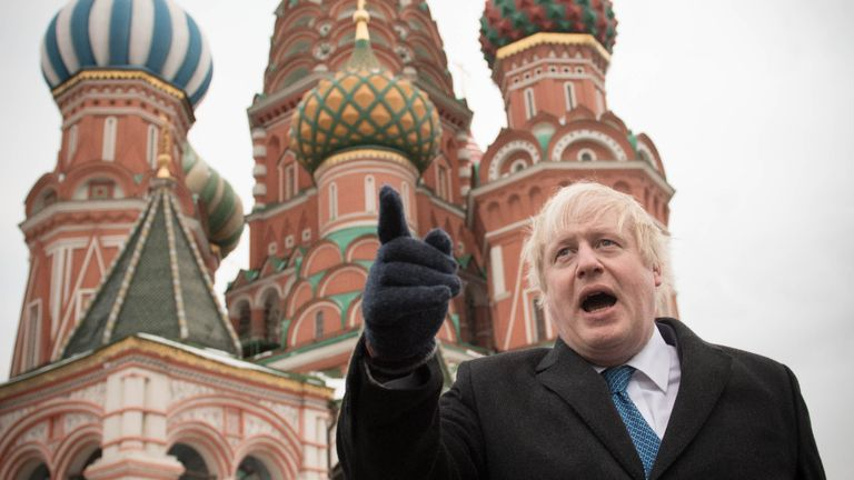 Foreign Secretary Boris Johnson stands in front of St Basil's Cathedral during a visit to Red Square in Moscow.