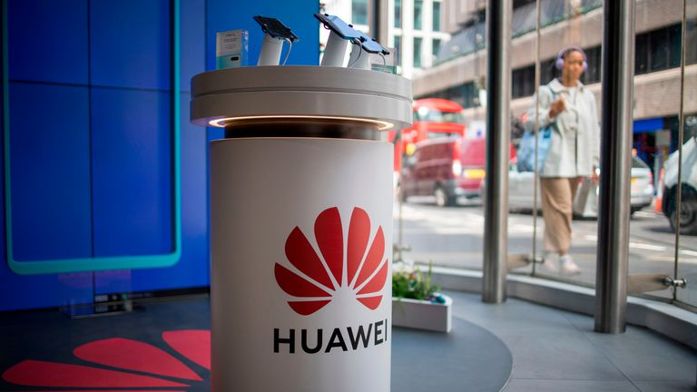 A pedestrian walks past a Huawei product stand at an EE telecommunications shop in central London on April 29, 2019. - British Foreign Secretary Jeremy Hunt has urged caution over the role of China's Huawei in the UK, saying the government should think carefully before opening its doors to the technology giant to develop next-generation 5G mobile networks. His comments come after Prime Minister Theresa May conditionally allowed China's Huawei to build the UK 5G network, information that was leaked to a newspaper from top secret discussions between senior ministers and security officials, a leak that has caused a scandal that has rocked Britain's splintered government. (Photo by Tolga Akmen / AFP)        (Photo credit should read TOLGA AKMEN/AFP via Getty Images)