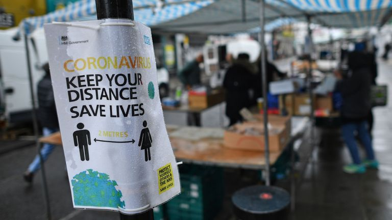A sign promotes social distancing at Portobello Road Market in London on June 6, 2020, as lockdown measures are partially eased during the novel coronavirus COVID-19 pandemic. - Outdoor markets swung open their gates on June 1, and car showrooms tried to lure back customers and recoup losses suffered since Britain effectively shut down for business on March 23, to ward off a disease that has now officially claimed more than 40,000 lives in the country. Britain's Health Ministry said 40,261 people who tested positive for COVID-19 had died as of 0800 GMT on Friday June 5. (Photo by Ben STANSALL / AFP) (Photo by BEN STANSALL/AFP via Getty Images)