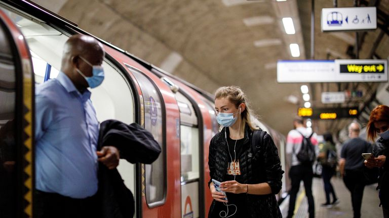 Commuters wearing a face mask travel on TfL Victoria Line underground train carriages, heading towards central London, on June 15, 2020 after new rules make wearing face coverings on public transport compulsory while the UK further eases its coronavirus lockdown. - New coronavirus pandemic rules coming into force on June 15 make wearing face coverings such as masks or scarves compulsory on public transport, as various stores and outdoor attractions open for the first time in nearly three months. (Photo by Tolga AKMEN / AFP) (Photo by TOLGA AKMEN/AFP via Getty Images)