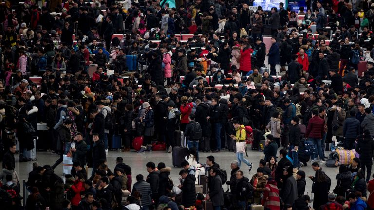 TOPSHOT - Passengers gather in the waiting hall at Hongqiao Railway Station ahead of the Lunar New Year holidays in Shanghai on February 6, 2018. China's official peak travel period for this year's Lunar New Year began on February 1 and authorities expect more than 390 million train trips to take place between February 1 and March 12. / AFP PHOTO / Johannes EISELE (Photo credit should read JOHANNES EISELE/AFP via Getty Images)