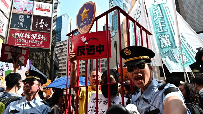 "TOPSHOT - Activists attend a protest in Hong Kong on April 28, 2019, against a controversial move by the government to allow extraditions to the Chinese mainland. - Hong Kong's government has recently announced plans to overhaul its extradition rules, allowing the transfer of fugitives with Taiwan, Macau and mainland China on a ""case-basis"" for the first time. (Photo by Anthony WALLACE / AFP)        (Photo credit should read ANTHONY WALLACE/AFP via Getty Images)"