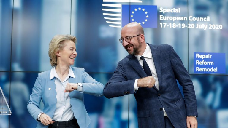 European Commission President Ursula Von Der Leyen (L) and European Council President Charles Michel (R) bump elbows at the end of the news conference following a four days European summit at the European Council in Brussels, Belgium, early July 21, 2020. - EU leaders approved a 750-billion-euro package to revive their coronavirus-ravaged economies after a tough 90-hour summit on July 21, along with a trillion-euro budget for the next seven years. (Photo by STEPHANIE LECOCQ / POOL / AFP) (Photo by STEPHANIE LECOCQ/POOL/AFP via Getty Images)