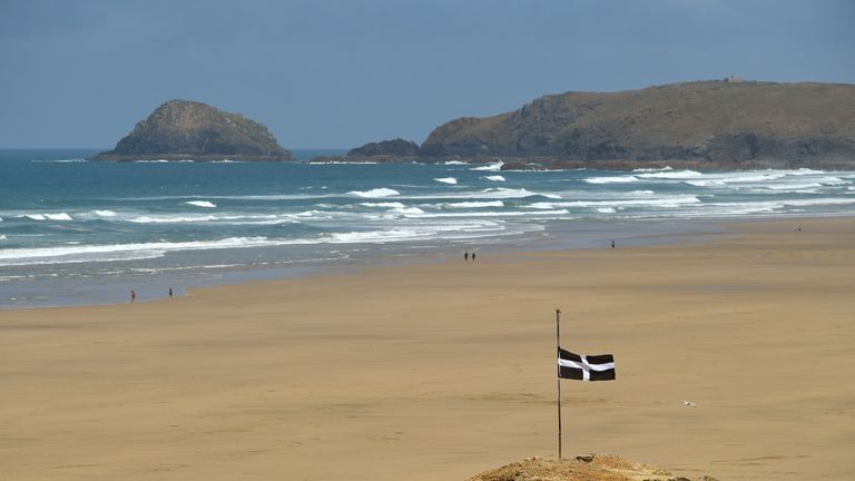 PERRANPORTH, ENGLAND - MAY 24: A Cornwall flag is flown at half mast at Perranporth Beach on May 24, 2020 in Perranporth, England. The British government has started easing the lockdown it imposed two months ago to curb the spread of Covid-19, abandoning its 'stay at home' slogan in favour of a message to 'be alert', but UK countries have varied in their approaches to relaxing quarantine measures. (Photo by Dan Mullan/Getty Images)