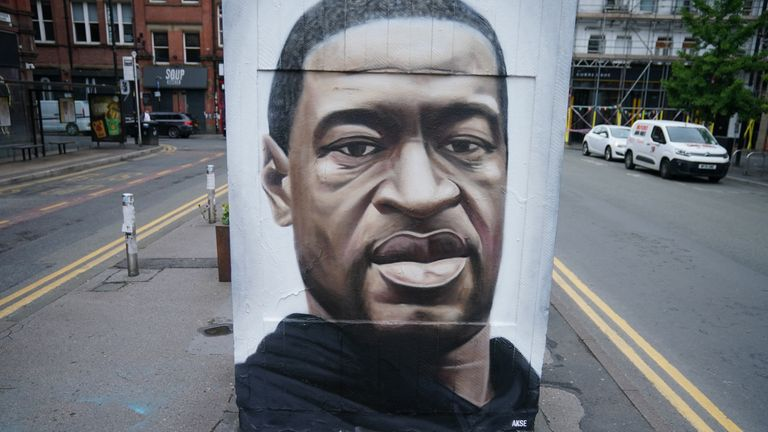 MANCHESTER, UNITED KINGDOM - JUNE 03: Floral tributes lay next to a mural of George Floyd, by street artist Akse, in Manchester's northern quarter on June 03, 2020 in Manchester, United Kingdom. The death of an African-American man, George Floyd, while in the custody of Minneapolis police has sparked protests across the United States, as well as demonstrations of solidarity in many countries around the world. (Photo by Christopher Furlong/Getty Images)
