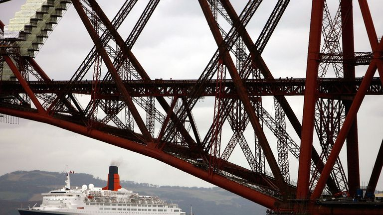 EDINBURGH, UNITED KINGDOM - SEPTEMBER 18: The Queen Elizabeth 2 anchors alongside the Forth bridges September 18, 2007 in Edinburgh, Scotland. The QE2 will be delivered to Dubai in November 2008, where it will cease its role as an ocean-going passenger vessel, to be refurbished to create a luxury floating hotel. (Photo by Jeff J Mitchell/Getty Images)