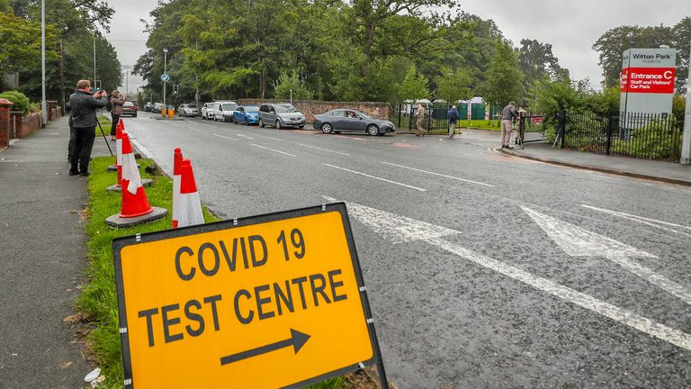 """A mobile testing centre at Witton Park High School in Blackburn and Darwen, as the town is facing a """"rising tide"""" of coronavirus cases, centered on its large Asian community."""