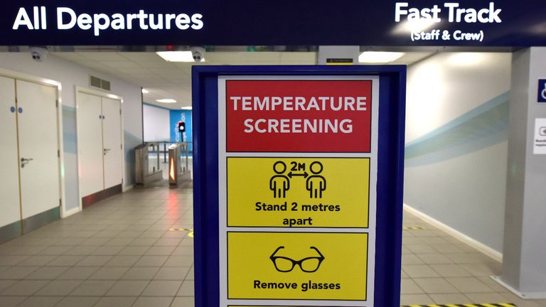 """SOUTHEND-ON-SEA, ENGLAND - JUNE 18: A """"Temperature Screening"""" sign and fever screening thermographic cameras which can measure higher body temperature at the departure gate as London Southend airport prepares for the reintroduction of passenger flights on June 18, 2020 in Southend-on-Sea, England. As the British government further relaxes Covid-19 lockdown measures in England, this week sees preparations being made to open non-essential stores and Transport for London handing out face masks to commuters. International travelers arriving in the UK will face a 14-day quarantine period. (Photo by John Keeble/Getty Images)"""