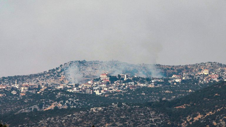 A picture taken from the Israeli side of the Blue Line that separates Israel and Lebanon shows smoke billowing above the Shebaa village sector in southern Lebanon, after reports of clashes in the border area, on July 27, 2020. (Photo by Jalaa MAREY / AFP) (Photo by JALAA MAREY/AFP via Getty Images)