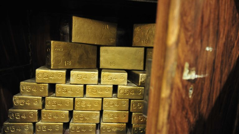 """A photo taken on November 29, 2011 shows gold ingots in an antique safe, about 100 years old, shown at the """"History of Money"""" exhibition at the Hungarian National Bank in Budapest. AFP PHOTO / ATTILA KISBENEDEK (Photo credit should read ATTILA KISBENEDEK/AFP via Getty Images)"""